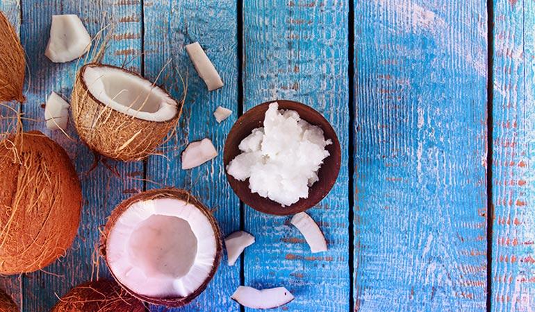 Coconut oil moisturizes hair and reverses damage