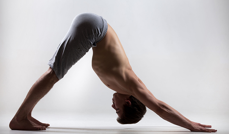 The downward-facing dog pose to stretch out the arms and legs.