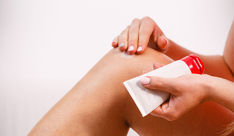 A mildly abrasive exfoliation helps remove the dead skin cells from the elbows and knees