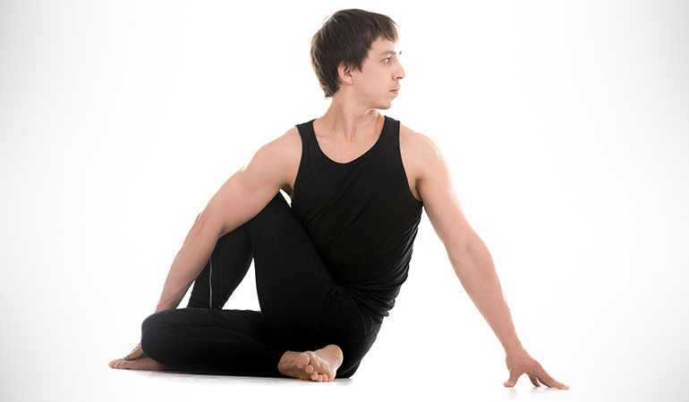 Half spinal twist pose release tension in the back muscles