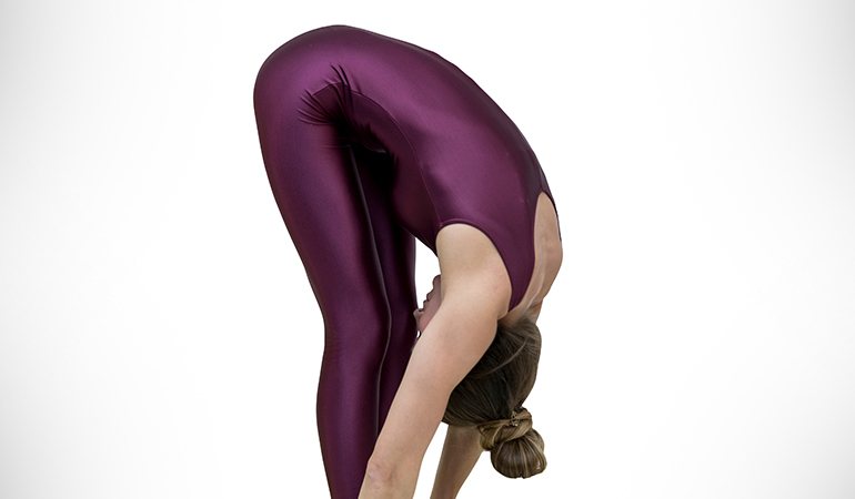 The hands-to-feet pose stretches out the lower back