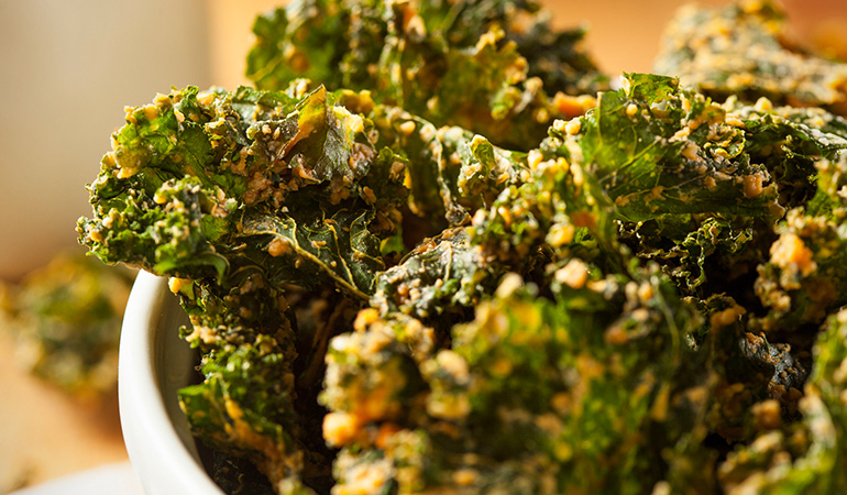 Roast kale chips with a dash of turmeric