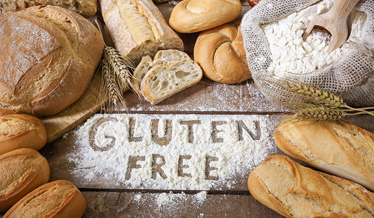 Celiac disease is triggered by eating foods containing gluten.
