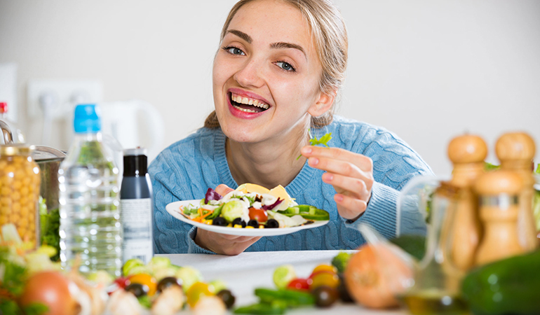 Eating vegetables before you dine out can help prevent you from going overboard on fatty, oily foods.
