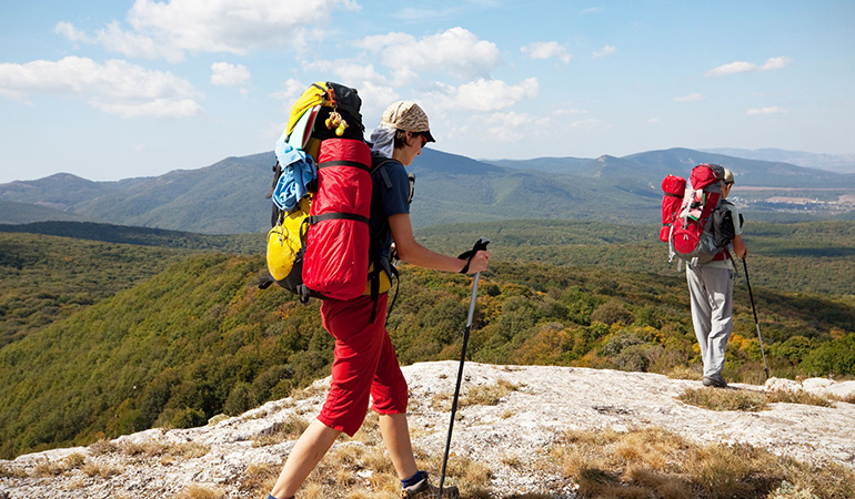 Take to hiking regularly to burn extra calories and tone your muscles