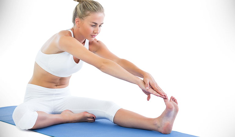 The one-leg toe touch releases tension in the hamstrings