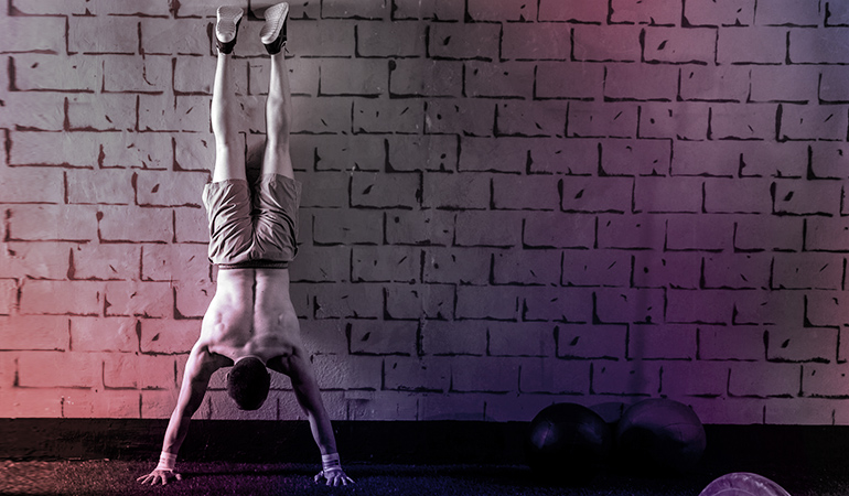 Handstand push-ups take time to master and look impressive