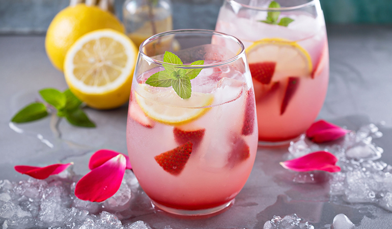 Detox water made using rose, strawberry, and lemon can help treat acne
