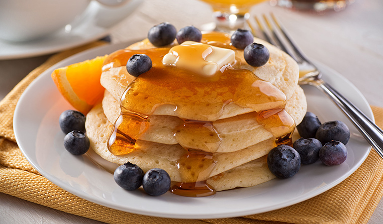 Pancakes and maple syrup are heavily laden with sugar