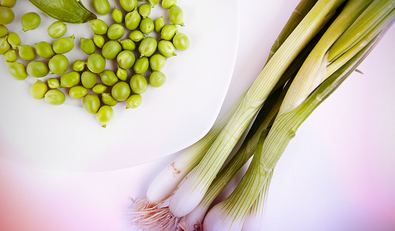 Onions, shallots, and garlic, when grown with peas, leave the pea plant stunted
