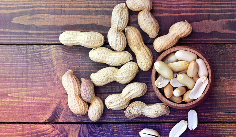 1 oz of peanuts has 1.30 mg iron.