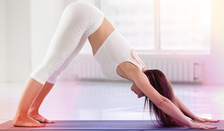The downward dog pose helps with digestion.