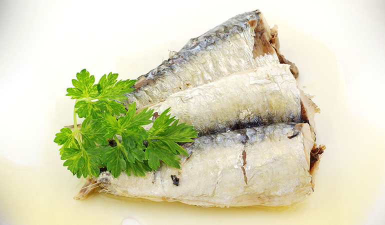 A cup of canned sardines has 1.23 mg of vitamin E (8.2% DV).