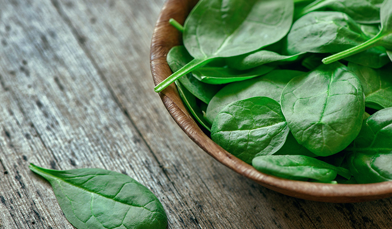 A cup of cooked spinach has 3.74 mg of vitamin E (24.9% DV).
