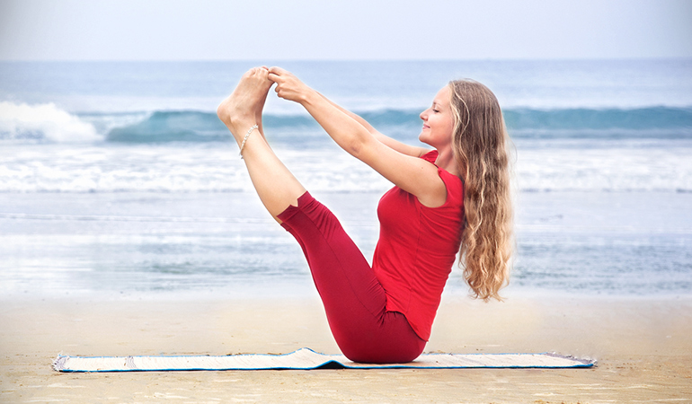 The boat pose strengthens core muscles, ankles, legs, and shoulders.