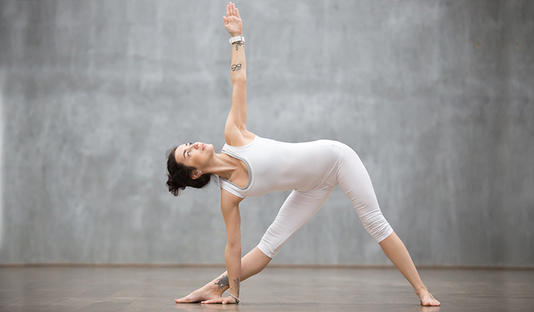 The extended triangle pose core muscles, arms, and legs.